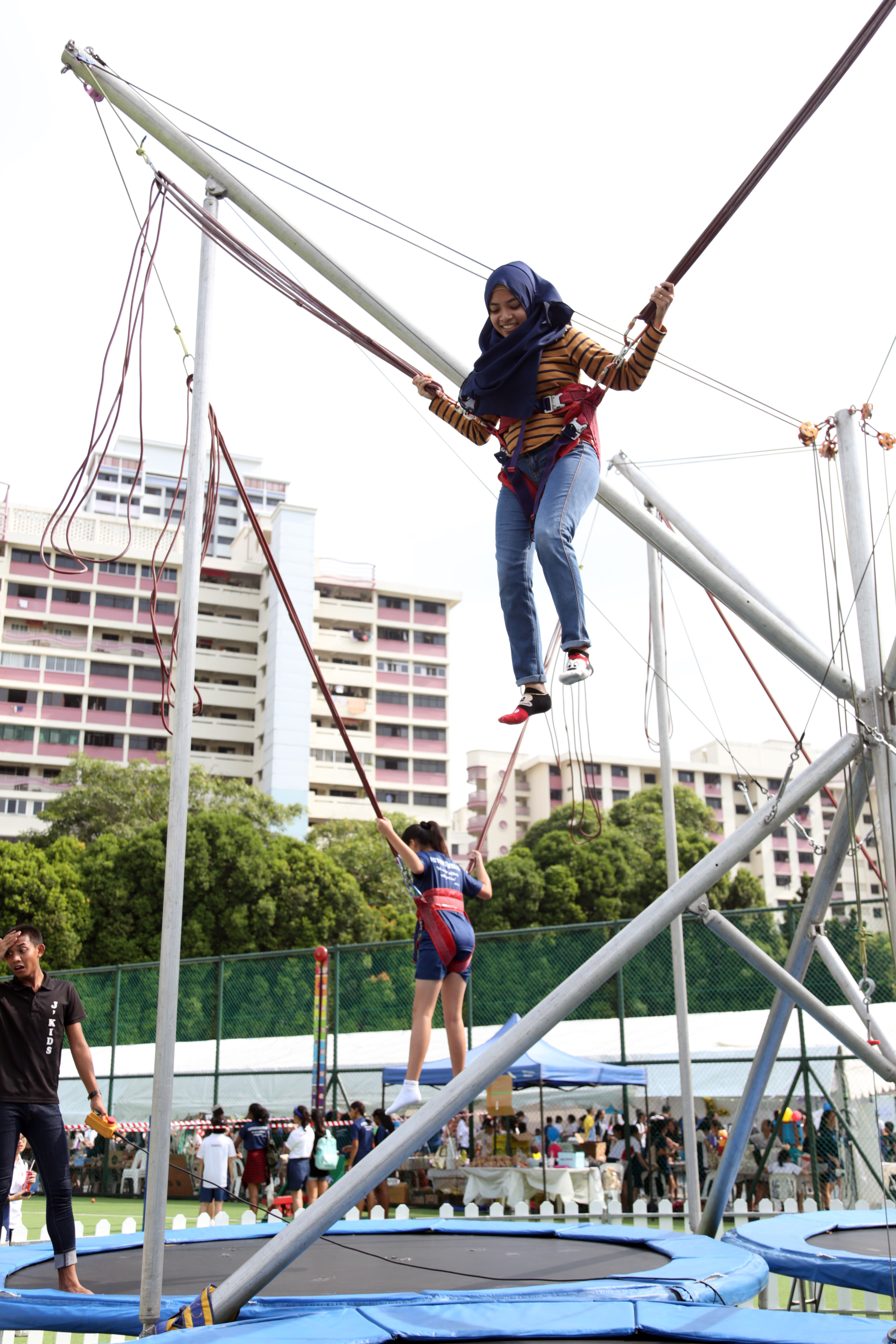 A visitor tries out the reverse bungee jump.JPG